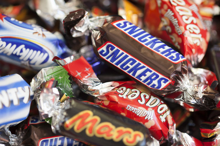 mars incorporated: Paphos, Cyprus - December 19, 2013 Snickers, Mars, Milky Way, Galaxy, Bounty and Maltesers Teasers candy heap. Full Frame. Studio shot. All these candies manufactured by Mars, Incorporated. Editorial