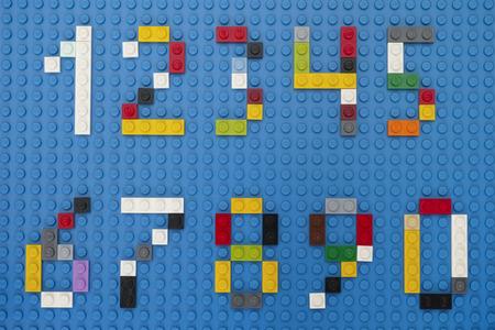 Tambov, Russian Federation - February 14, 2015 Lego custom numbers on Lego blue baseplate background. Studio shot.