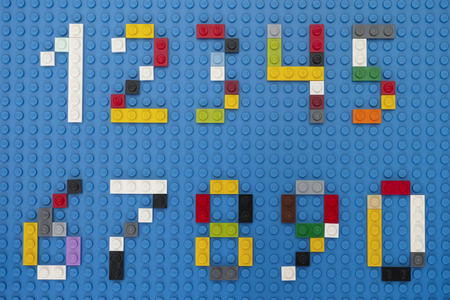 Tambov, Russian Federation - February 14, 2015 Lego custom numbers on Lego blue baseplate background. Studio shot.