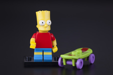 simpson: Tambov, Russian Federation - April 30, 2014 Lego Bart Simpson minifigure with skateboard on black background. Studio shot.