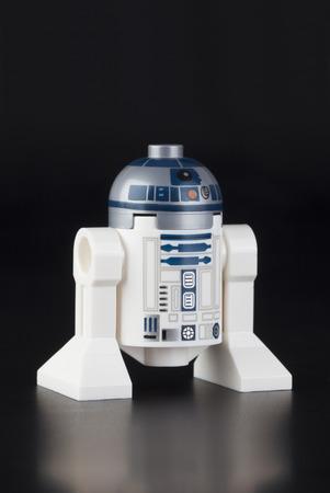 incorporates: Tambov, Russian Federation - June 21, 2014 LEGO Star wars R2-D2 minifigure on black background. Studio shot. Lego Star Wars is a Lego theme that incorporates the Star Wars saga. Editorial