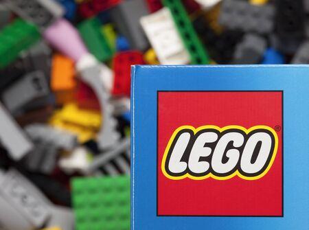 Tambov, Russian Federation - January 12, 2015 Lego logo on the box with Lego blocks background. Adobe RGB. Studio shot.