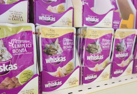 mars incorporated: Paphos, Cyprus - December 09, 2013 Cats food by Whiskas on store shelves. Cats food by Whiskas on store shelves. Whiskas (formerly known as Kal Kan) is a brand of cat food sold throughout the world. It is owned by the American group Mars, Incorporated.