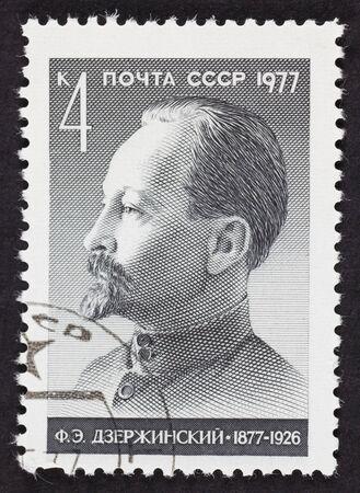 stamp collecting: USSR postage stamp Felix Edmundovich Dzerzhinsky. 1977 year. Black background.
