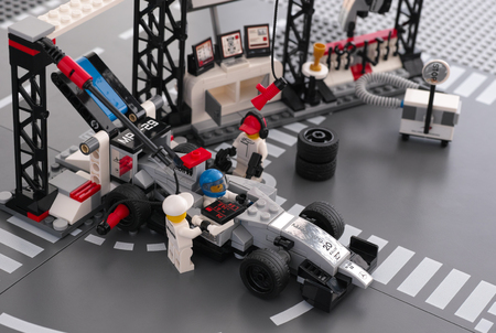 pit stop: Tambov, Russian Federation - June 24, 2015 MP4-29 race car in McLaren Mercedes Pit Stop by LEGO Speed Champions with fully equipped convertible pit stop. Studio shot.