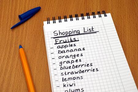 ballpoint pen: Handwritten fruits shopping list with ballpoint pen.