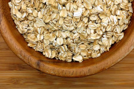 oatmeal bowl: Oatmeal in a wooden bowl