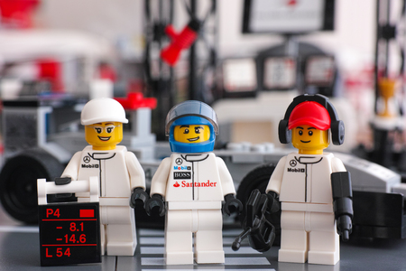 Tambov, Russian Federation - June 24, 2015 Lego McLaren Mercedes team crew members minifigures by LEGO Speed Champions opposite pit stop. Studio shot.
