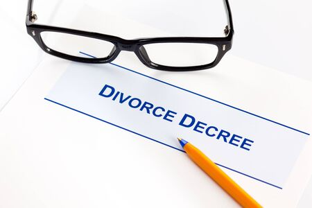 decree: Divorce Decree with glasses and ballpoint pen. Stock Photo