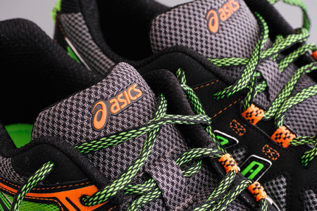 snickers: Tambov, Russian Federation - September 17, 2015 Asics snickers. Close-up. Studio shot.