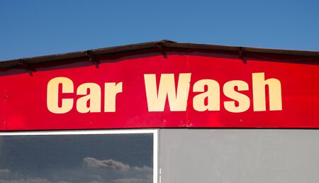 wash: Words Car Wash on building Stock Photo
