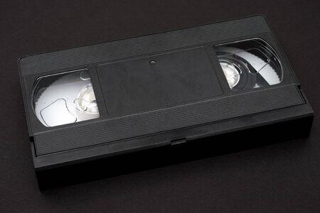 videocassette: cinta de v�deo sobre fondo negro