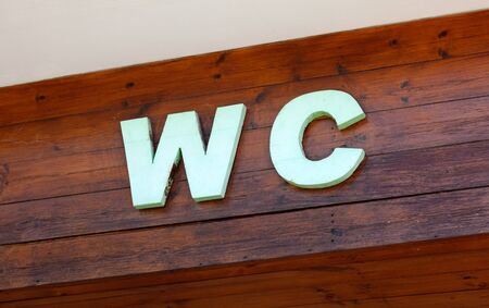c a w: Letter WC on wooden planks Stock Photo