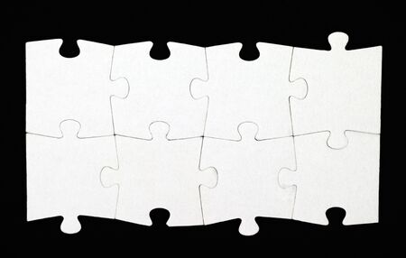 jigsaw puzzle pieces: Eight pieces of puzzle are connected together on black background Stock Photo