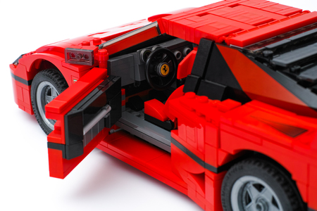 creator: Tambov, Russian Federation - January 03, 2016 LEGO Creator Expert Ferrari F40 car with open driver door on white background. Studio shot. Editorial