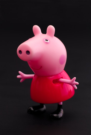 Tambov, Russian Federation - December 16, 2015 Peppa Pig toy character on black background. Studio shot.