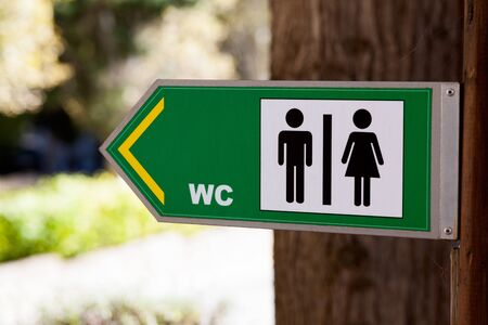 public toilet: Sign for WC in park Stock Photo