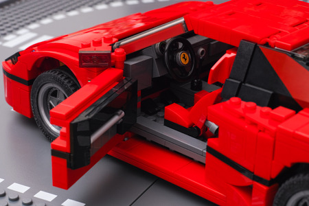 creator: Tambov, Russian Federation - January 03, 2016 LEGO Creator Expert Ferrari F40 car with open driver door on Lego road baseplate. Studio shot. Editorial