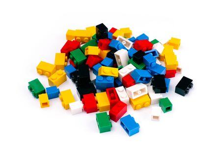 yellow lego block: Tambov, Russian Federation - February 19, 2015 Heap of colorful Lego Blocks on white background. Studio shot. Editorial