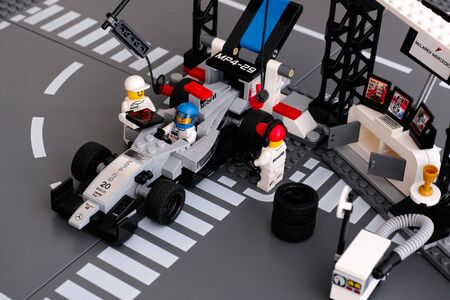 pit stop: Tambov, Russian Federation - June 24, 2015 Lego MP4-29 race car in McLaren Mercedes Pit Stop by LEGO Speed Champions with fully equipped convertible pit stop with crew. Studio shot. Editorial