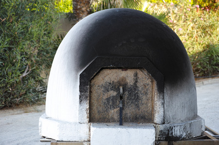 soot: Cyprus traditional domed wood burning stove. Outdoors.