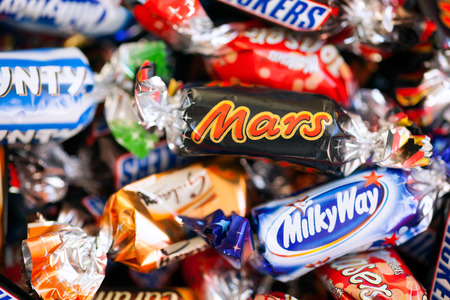 incorporated: Paphos, Cyprus - December 19, 2013 Heap of Mars, Snickers, Milky Way, Galaxy, Bounty and Maltesers Teasers candies. All candies manufactured by Mars Incorporated. Studio shot.