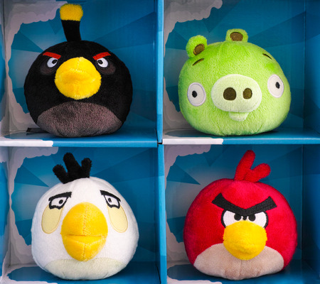 plush toys: Tambov, Russian Federation - February 28, 2016 Angry Birds collectible plush toys 4 pack in paper boxes. There are Bomb, Minion Pig, Matilda and Red. Studio shot. Editorial