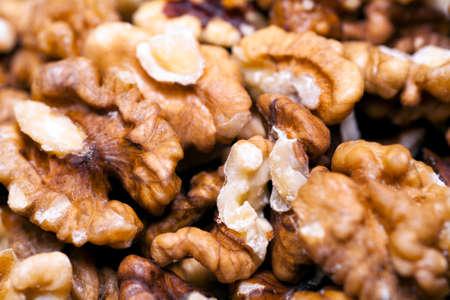 heap: Heap of walnut kernels.