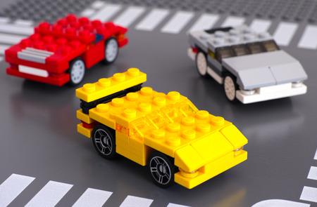 custom car: Tambov, Russian Federation - March 15, 2015 Three Lego custom cars on Lego road baseplate. Car made by my 5 years son. Studio shot.