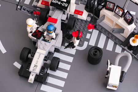pit stop: Tambov, Russian Federation - June 24, 2015 Lego MP4-29 race car in fully equipped convertible McLaren Mercedes Pit Stop by LEGO Speed Champions with crew. Studio shot.