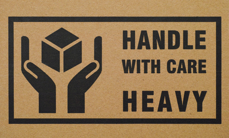 handle with care: Sign Handle with care Heavy on  cardboard box
