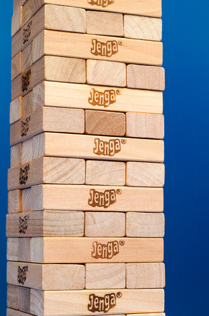 constructed: Tambov, Russian Federation - March 03, 2016 Jenga tower constructed with blue background. Studio shot. Editorial