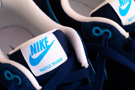 nike: Tambov, Russian Federation - May 10, 2015: New blue Nike waffle trainer shoes. Close-up. Studio shot.