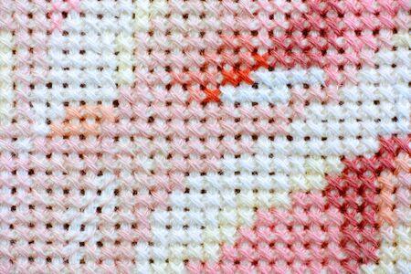 stitch: Cross stitch background. Close up.