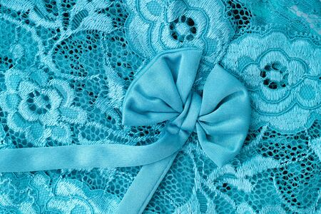 celadon green: Aquamarine lace with bow background. Close up.