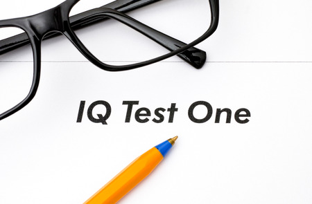 iq: IQ test One with glasses and ballpoint pen