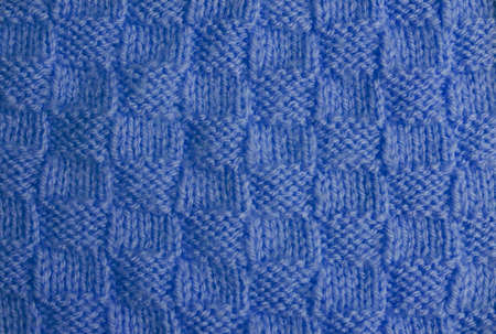 needlecraft product: Blue hand knitted texture. Close-up. Stock Photo