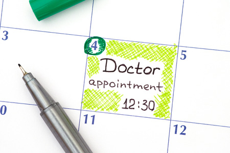 Reminder Doctor appointment 12-30 in calendar with green pen. Фото со стока