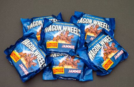 six packs: Tambov, Russian Federation - May 31, 2016 Six packs of Jammie Wagon Wheels Limited edition. Studio shot. Wagon Wheels consist of two biscuits with marshmallow and jam centre, covered in chocolate coating.