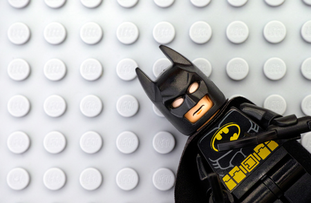 batman: Tambov, Russian Federation - May 12, 2016 Lego Batman minifigure on Lego gray baseplate background. Studio shot. Editorial