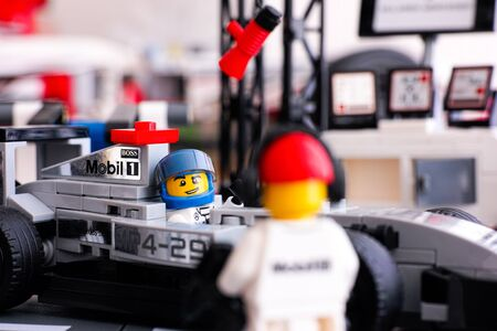 pit stop: Tambov, Russian Federation - June 24, 2015: Lego McLaren Mercedes MP4-29 race car with driver minifigure in McLaren Mercedes Pit Stop by Lego Speed Champions. Studio shot.