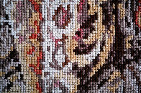 stitch: Multicolor cross stitch background. Closeup.