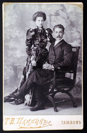 20th century: Tambov, Russian Federation - March 29, 2015 Vintage photograph of couple. Photo was taken at beginning of 20th century in Tambov by Tsaplin photo studio. Studio shot.