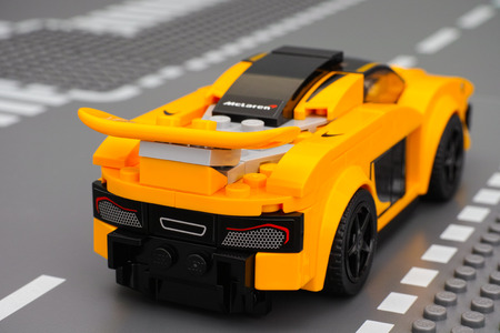yellow lego block: Tambov, Russian Federation - March 04, 2015 McLaren P1 car by LEGO Speed Champions on the Lego road baseplate. Back view. Studio shot.