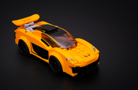 yellow lego block: Tambov, Russian Federation - March 04, 2015 McLaren P1 car by Lego Speed Champions on black background. Studio shot.
