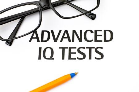 iq: Advanced IQ tests with glasses and ballpoint pen Stock Photo