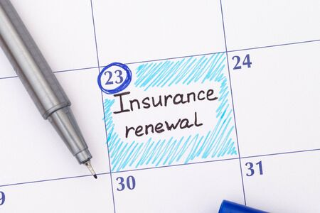 Reminder Insurance Renewal in calendar with pen. Stock Photo