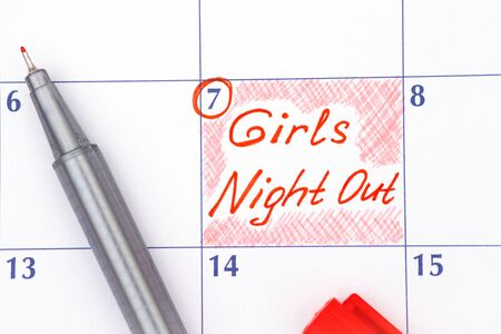 out of date: Reminder Girls Night Out in calendar with red pen