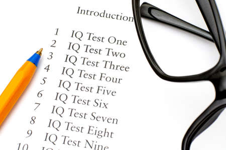 iq: Contents book with Introduction and IQ Tests with glasses and ballpoint pen.