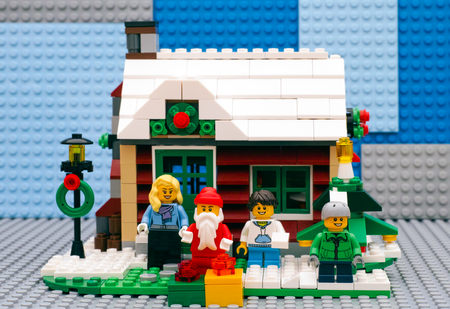 figurine: Tambov, Russian Federation - July 06, 2016 Lego Winter House ready for Christmas. Santa Claus with gifts, mother, son and daughter standing in front of house. Studio shot. Editorial